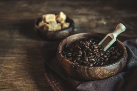 coffee beans and brown sugar in bowls on wooden tabletop Stock Photo