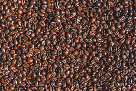 close up of heap of roasted aromatic brown coffee beans Stock Photo