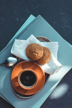 top view of coffee with cookies on cloth and books at tabletop Stok Fotoğraf