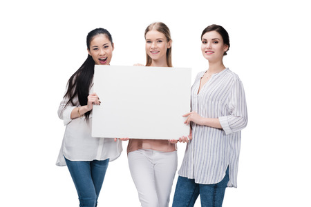 smiling girls holding blank banner isolated on white