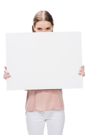 young woman holding blank banner isolated on white