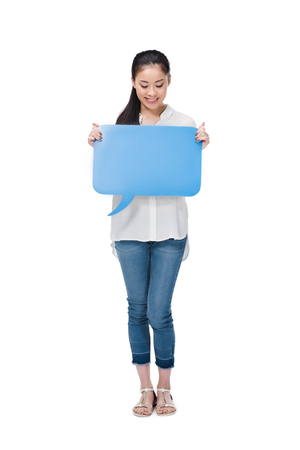 young asian woman holding blue blank speech bubble