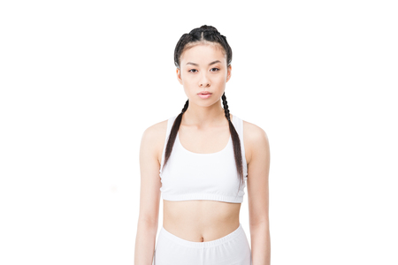 asian girl with braids in white sportswear looking at camera Stock Photo