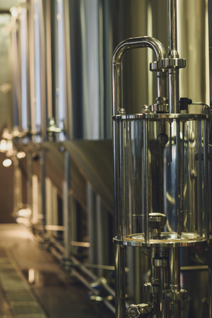 Modern brewery equipment with stainless tanks for the fermentation beer