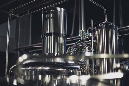 Modern brewery equipment with pipes and fermenting tank Stock Photo