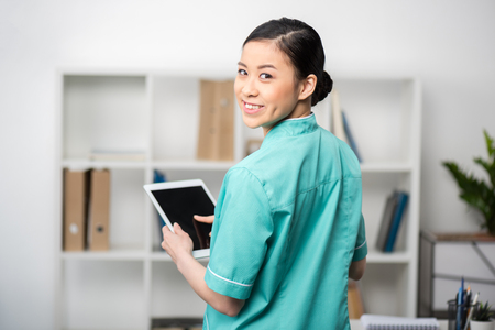 asian internist using digital tablet in professional clinic Stock Photo