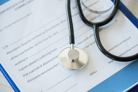 stethoscope lying on clipboard with diagnosis in medical clinic Stock Photo