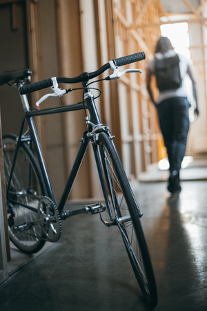 black hipster bicycle and man walking behind Stock Photo