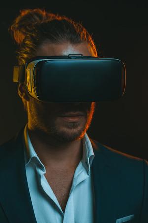 stylish young man using virtual reality headset