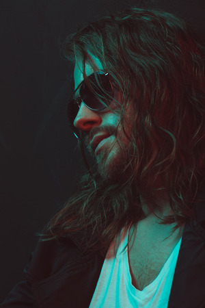 young long haired caucasian man in sunglasses