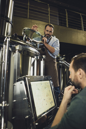 Brewers working with tanks
