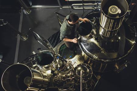 Brewer inspecting tank Stock Photo