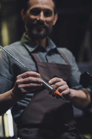 Brewery worker holding thermometer