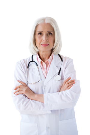 confident senior doctor looking at camera with crossed arms