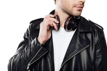 partial view of man in leather jacket with headphones isolated on white Reklamní fotografie