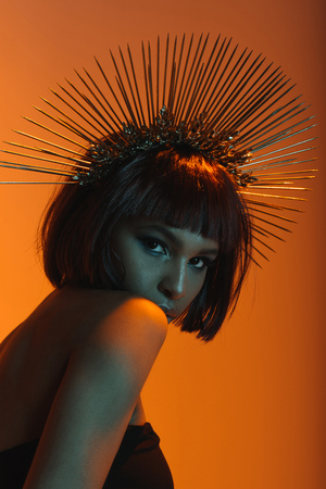 fashionable african american girl in headpiece with needles looking at camera Stock Photo