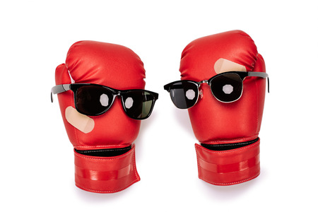 smiley: Pair of red boxing gloves in sunglasses making smiley composition Stock Photo