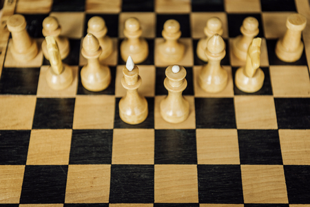 part of a chess board with chess king and queen staying in front of white chess pieces Reklamní fotografie