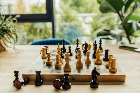 black and white chess pieces on chessboard during the game
