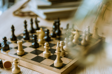 black and white chess figures on chess board at the table