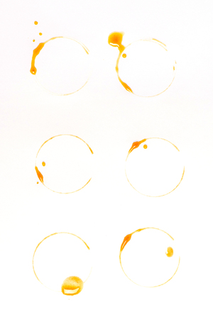 brown coffee stains and drops isolated on white