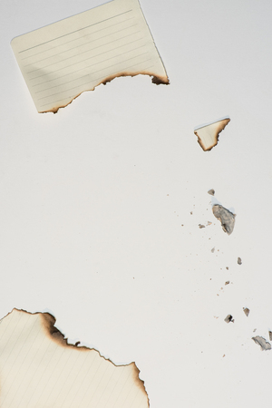 burned out: pieces of empty writing paper sheet with burned edges