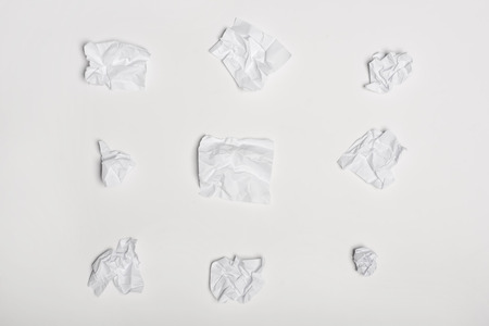 top view of crumpled white note papers