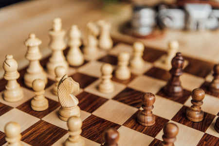 chess set on chessboard. Selective focus on white chess horse figure 版權商用圖片