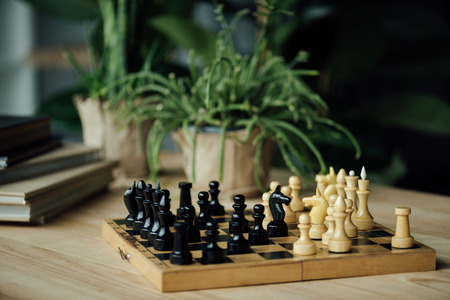 Chess pieces knights standing head to head on chessboard on the table