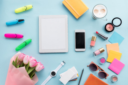 flat lay with tablet, smartphone, various accessories and flowers