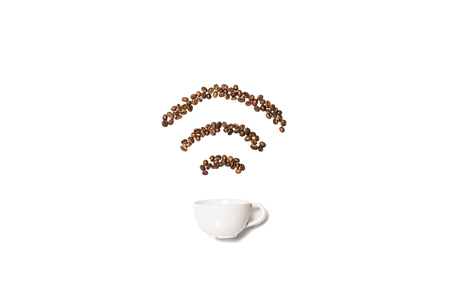 White cup with coffee beans in shape of Wi-Fi symbol Фото со стока