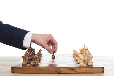 businessman playing chess alone isolated on white Zdjęcie Seryjne