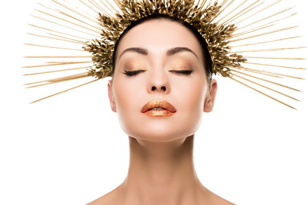 woman in golden headpiece posing with closed eyes isolated on white Stock Photo