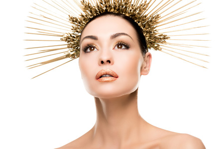portrait of fashionable woman posing in golden headpiece Stock Photo