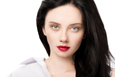 portrait of woman with red lips looking at camera looking at camera