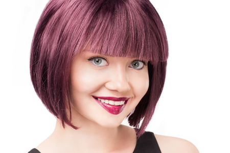 Portrait of smiling woman with purple hair looking at camera