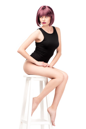 attractive girl with purple hair posing on chair