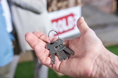 saleman holding keys of new house, house for sale concept Фото со стока