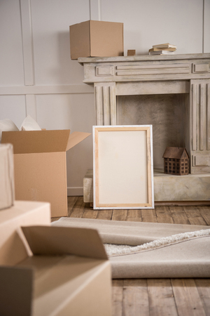 Picture Frame And Cardboard Boxes In Empty Room Stock Photo Picture
