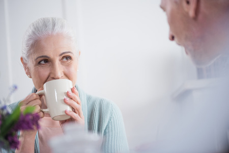 couple drinking tea during breakfast at home in the morning