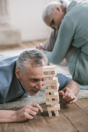 couple playing wood blocks game at home Stock Photo