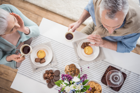 senior couple having breakfast at home Stock Photo