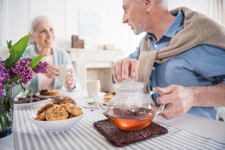 senior couple drinking tea during breakfast at home