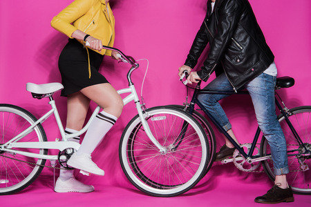 stylish elderly couple in leather jackets riding bicycles together Stock fotó