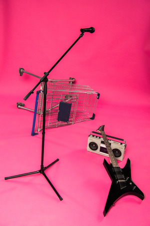 Electric guitar with tape recorder, microphone and shopping trolley Stock Photo