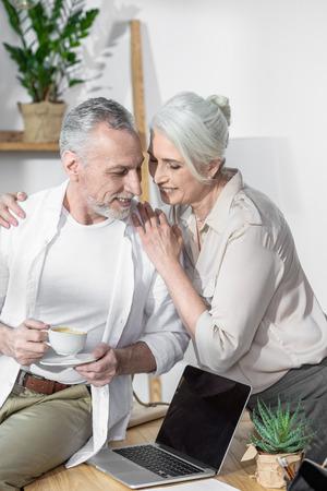 converse: senior couple converse together