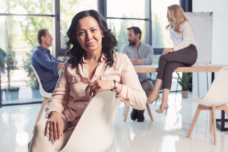 asian businesswoman sitting at office and looking at camera Stock Photo