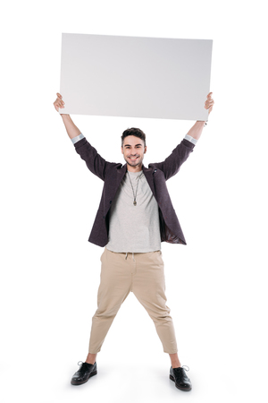 young caucasian man holding blank board