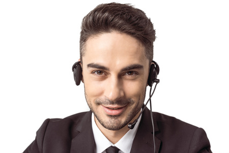 young call center operator in headset looking at camera isolated on white
