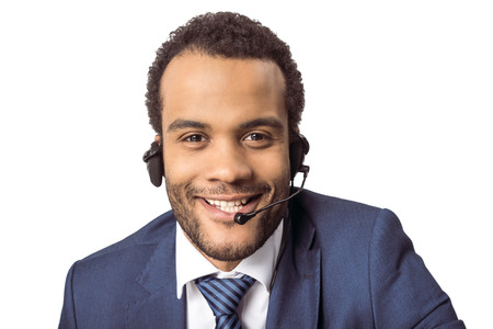 young african american call center operator in headset looking at camera